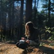 woman-praying-forest